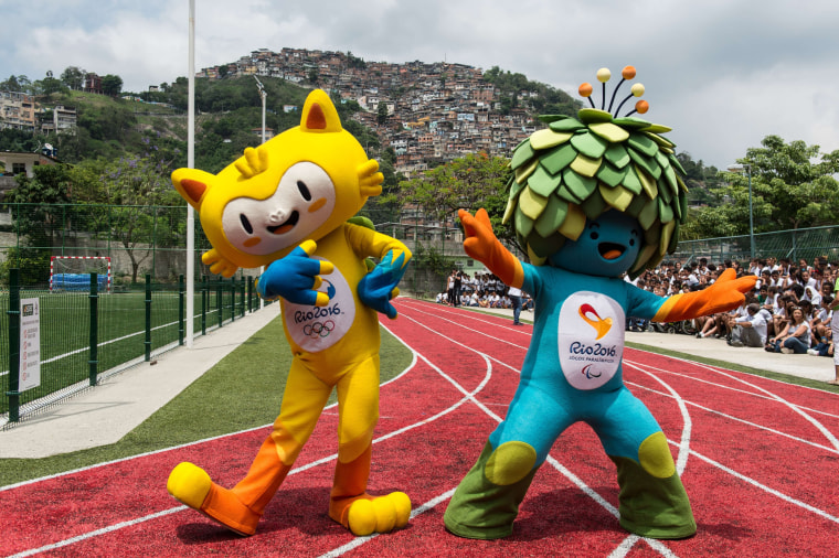 The new mascots for the Rio 2016 Olympic Games (L) and the Rio 2016 Paralympic Games, are presented at the Ginasio Experimental Olimpico Juan Antonio Samaranch in Rio de Janeiro, Brazil, on November 24, 2014. The Rio Olympic Games have their mascot, a yellow feline animal representing Brazil's rich fauna and wildlife, while the Paralympic Games mascot is a predominantly blue and green figure whose head of covered with leaves -- depicting once again the host country's rich vegetation as Brazil prepares to welcome the Olympics to South America for the first time. It remains only for the public to decide on a name, choosing from a range of options.