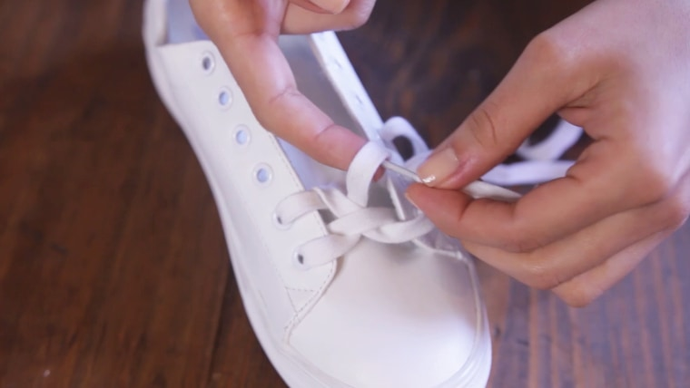 You'll repeat this crossing and looping until you reach the top of the shoe.