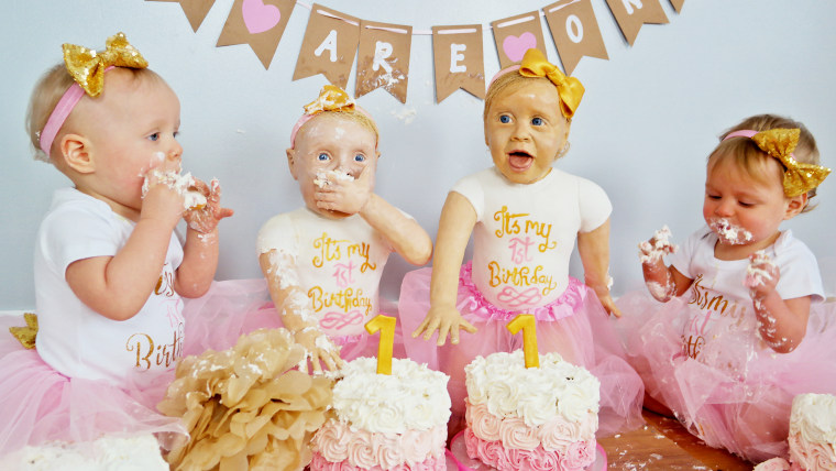 An amateur baker has created life-size cake versions of her twin daughters to celebrate their first birthday.