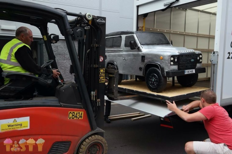Lara Mason's Land Rover cake gets transported by fork lift.