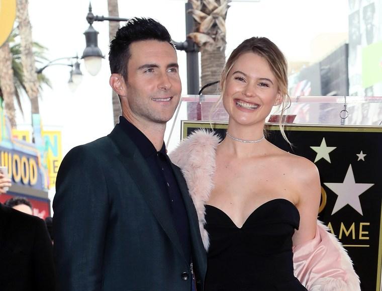 Adam Levine (L) and wife model Behati Prinsloo
