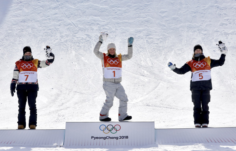 From left: silver medal winner Laurie Blouin, of Canada, gold medal winner Jamie Anderson, of the United States, and bronze medal winner Enni Rukajarvi, of Finland, celebrate after the women's slopestyle final.