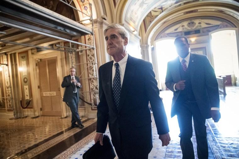 Image: Robert Mueller departs after a closed-door meeting
