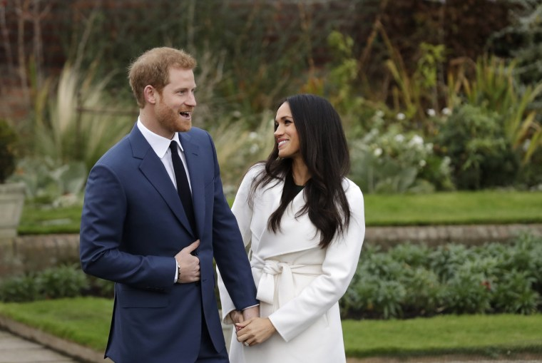 Image: Britain's Prince Harry and his fiancee Meghan Markle