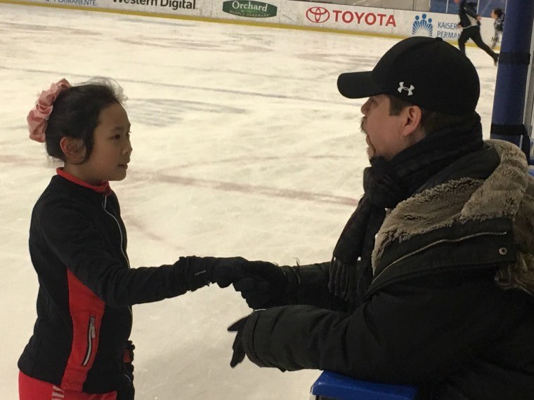 Galindo offers encouragement to young skater Elizabeth Ho.