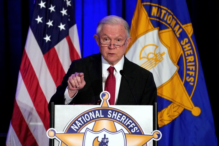 Image: Jeff Sessions delivers remarks on law enforcement efforts to combat the opioid crisis and violent crime in an address before the National Sheriffs Association Winter Conference in Washington