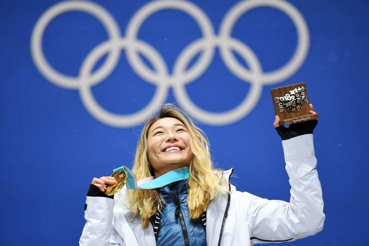 Image: Chloe Kim hold her gold medal
