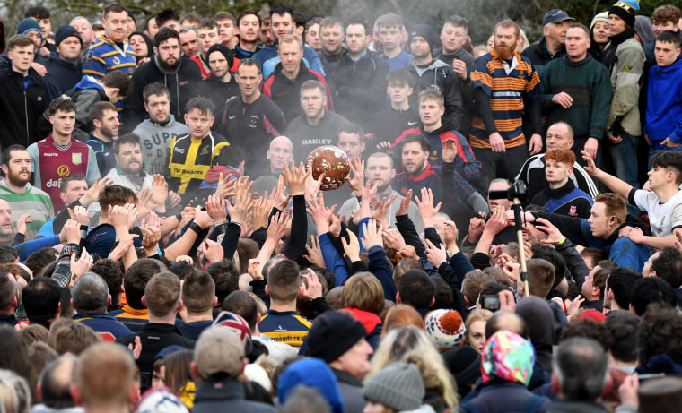 "Image: Rival teams ""Up'ards"" and ""Down'ards"" battle for the ball during the Royal Shrovetide Football match in Ashbourne"