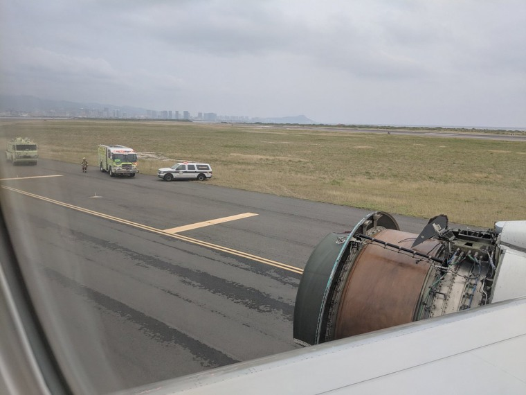 Image: Erik Haddad's view outside the window of his United flight 1175 showed the lost cowling on the right engine, on Feb. 13, 2018.