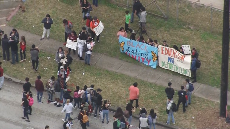 Image: Students at a Houston high school stage a walkout protesting recent deportations