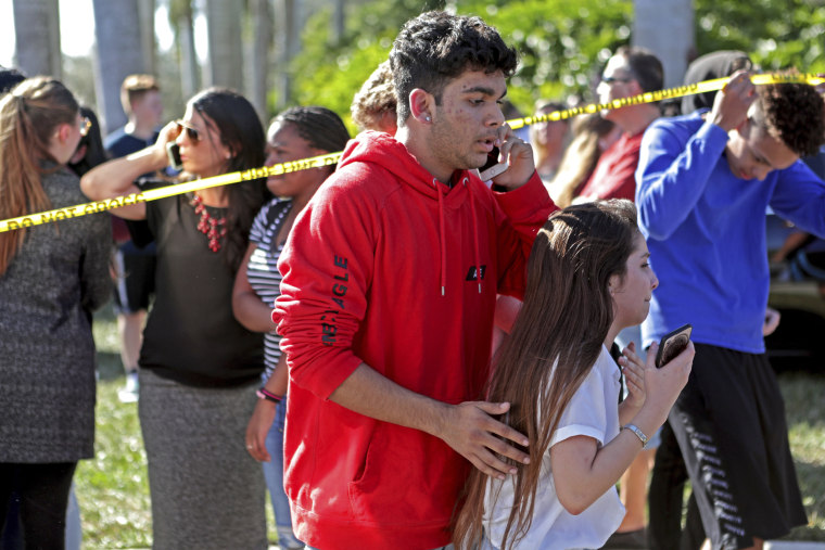Image: Students released from a lockdown are overcome with emotion