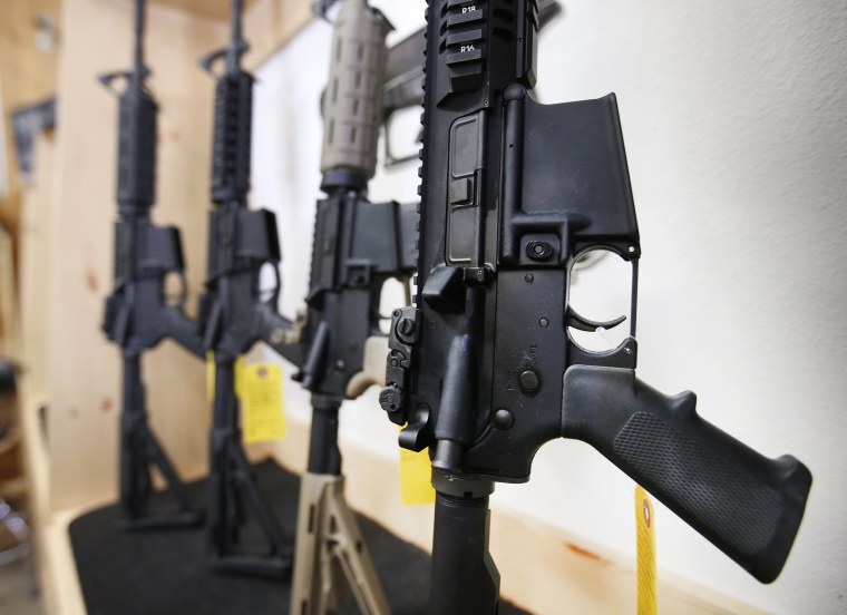 Image: AR-15 semi-automatic guns are on display for sale at Action Target o