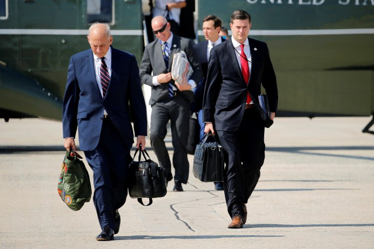 Image: Porter and Kelly walk to board Air Force One with Trump at Joint Base Andrews, Maryland