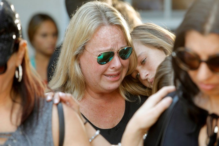 Image: Mourners react during a community prayer vigil at Parkridge Church in Pompano Beach