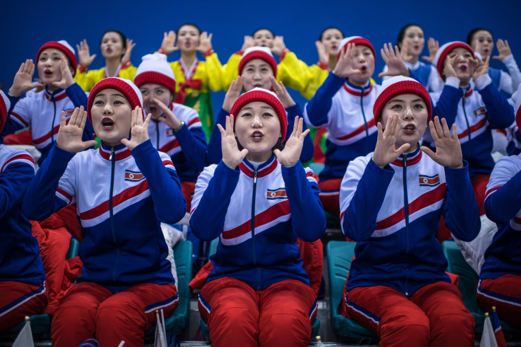 Image: North Korean cheerleaders chant during the women's ice hockey preliminary game