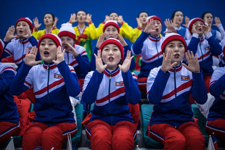 Image: North Korean cheerleaders chant during the women's ice hockey preliminary game