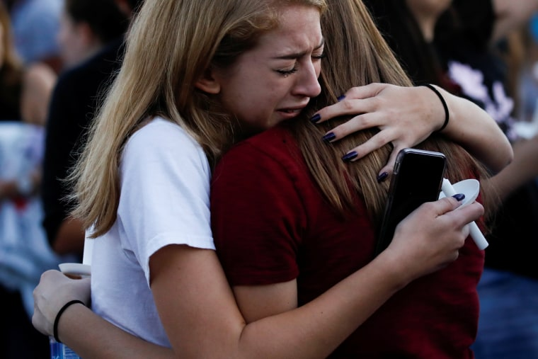Students mourn during a candlelight vigil.