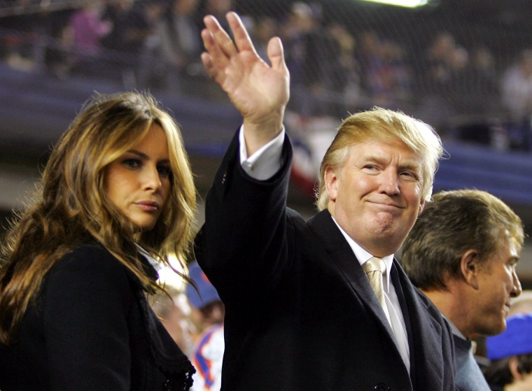 Image: Donald Trump waves to fans as he arrives with his wife Melania Knauss