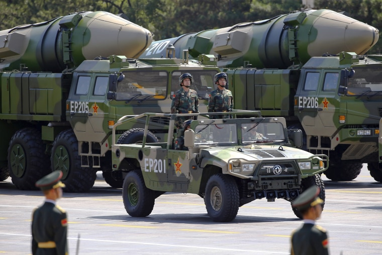 Military vehicles carrying DF-21D ballistic missiles roll through Tiananmen Square in 2015.