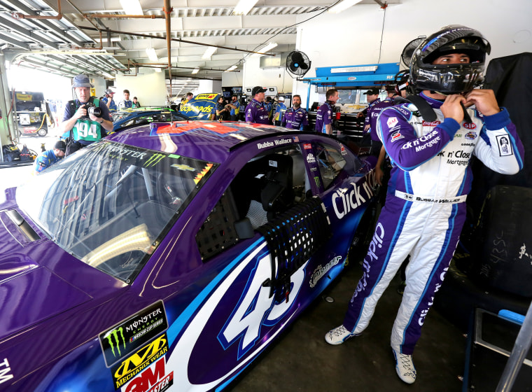 Image: Darrell Wallace Jr., driver of the #43 Click n' Close Chevrolet, climbs into his car in the garage area during practice for the Monster Energy NASCAR Cup Series Daytona 500 at Daytona International Speedway on Feb. 10, 2018.