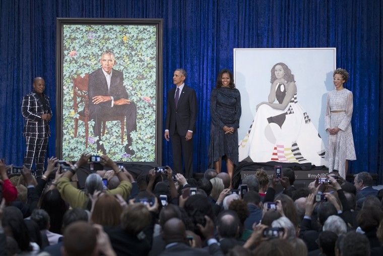 Image: Portraits of former US President Barack Obama and former First Lady Michelle Obama at the Smithsonian's National Portrait Gallery