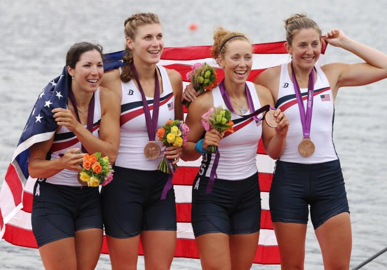 Image: U.S. rowers Adrienne Martelli, Megan Kalmoe, Kara Kohler, and Natalie Dell display the bronze medals they won