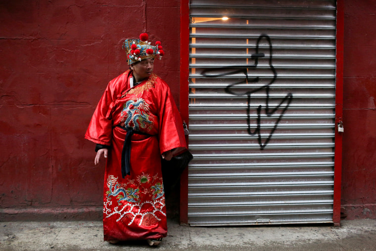 Image: Ken wears traditional clothing to celebrate the Chinese Lunar New Year of the Dog in Manhattan's Chinatown in New York
