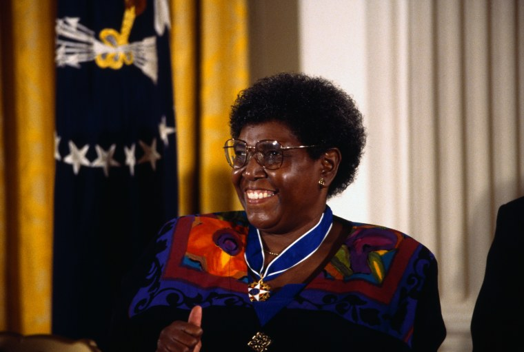 """Image: Former Congresswomen Barbara Jordan smiles with a """"thumbs up"""" as she receives a Presidential Medal of Freedom at the White House."""