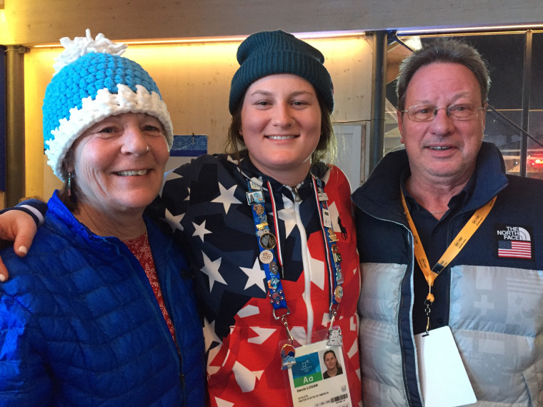 Devin Logan bonds with her parents Nancy and Jerry Logan while competing in the 2018 Winter Olympics.