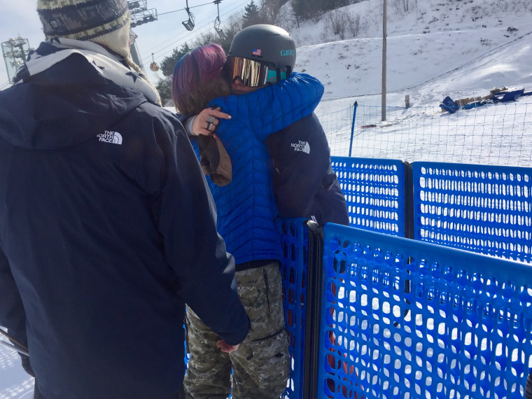 Devin Logan is comforted by her parents after the qualifying round for halfpipe skiing didn't go as planned.