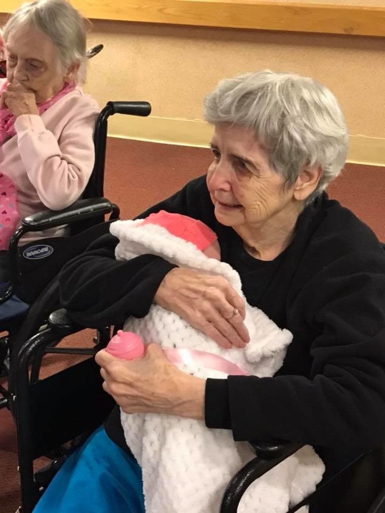 Alzheimer's patients show joy when they receive baby dolls