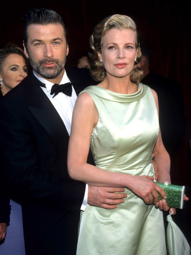 Alec Baldwin and Kim Basinger during The 70th Annual Academy Awards - Red Carpet at Shrine Auditorium in Los Angeles, California.