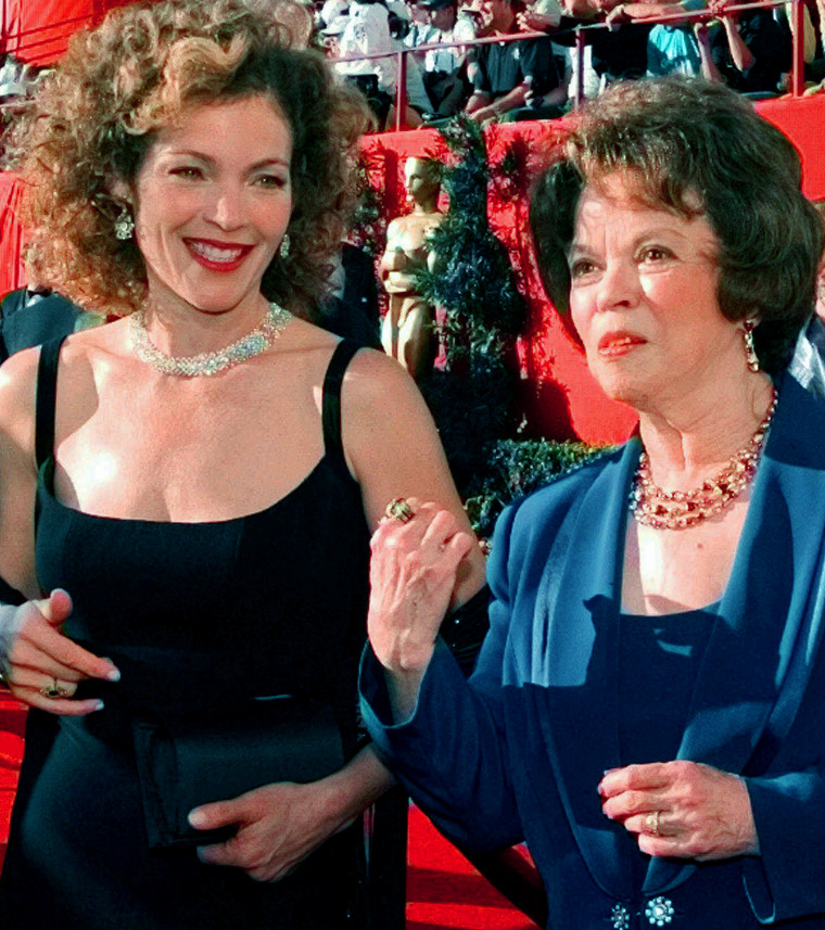 Actress Amy Irving, left, talks with Shirley Temple Black as they greet each other at the 70th Academy Awards at the Shrine Auditorium in Los Angeles March 23, 1998.