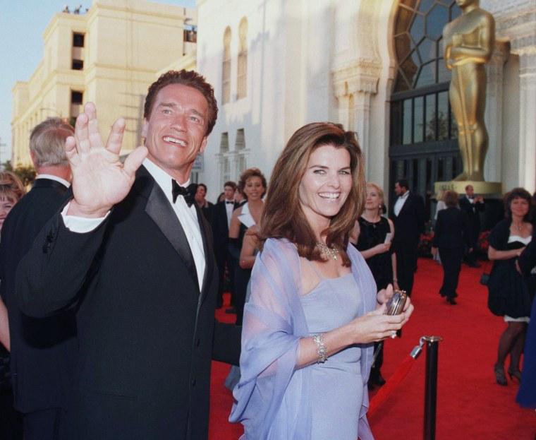 Arnold Schwarzenegger and his wife reporter Maria Shriver arrive for the 70th Annual Academy Awards 23 March in Los Angeles, CA.