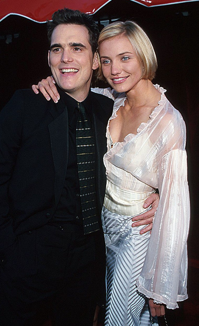 Matt Dillon and Cameron Diaz during The 70th Annual Academy Awards - Red Carpet at Shrine Auditorium in Los Angeles, California.