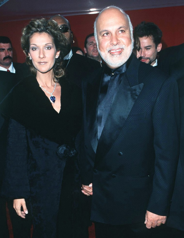 Celine Dion and husband Rene Angelil during The 70th Annual Academy Awards - Red Carpet at Shrine Auditorium in Los Angeles, California.