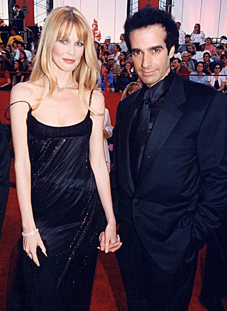 Claudia Schiffer & David Copperfield at the 1998 Academy Awards in Los Angeles.
