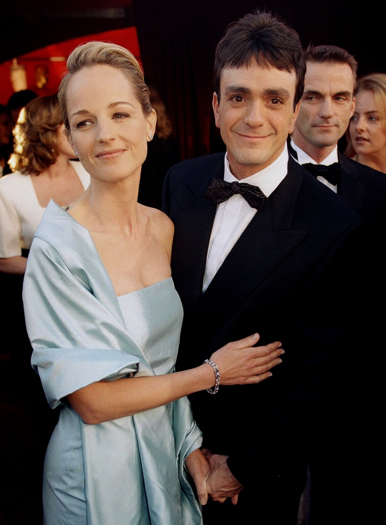 Helen Hunt, winner in the Best Actress category for her performance in the film As Good As It Gets, arrives at the 70th Annual Academy Awards with actor Hank Azaria at the Shrine Auditorium in Los Angeles on March 23, 1998.