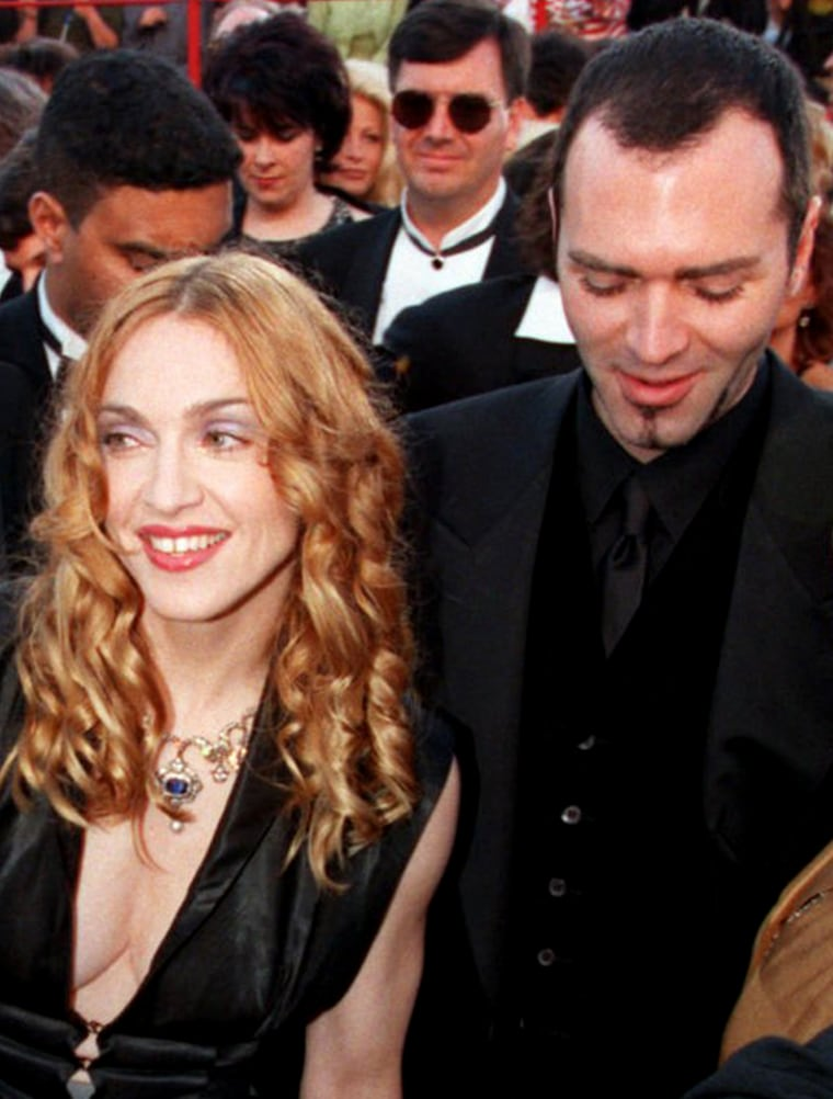 Madonna and her brother Christopher Ciccone arrive for the 70th Academy Awards show, Monday, March 23, 1998 in Los Angeles.