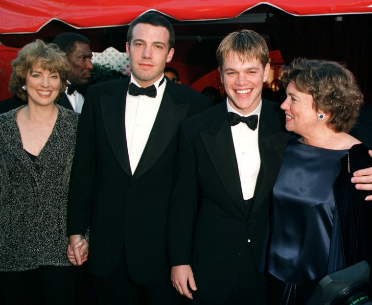 """Actor-writers Ben Affleck and Matt Damon arrive with their mothers Chris and Nancy at the 70th Annual Academy Awards 23 March in Los Angeles, CA. Affleck and Damon are nominted for best original screenplay for """"Good Will Hunting."""" Damon is also nominated for best actor for the same film."""