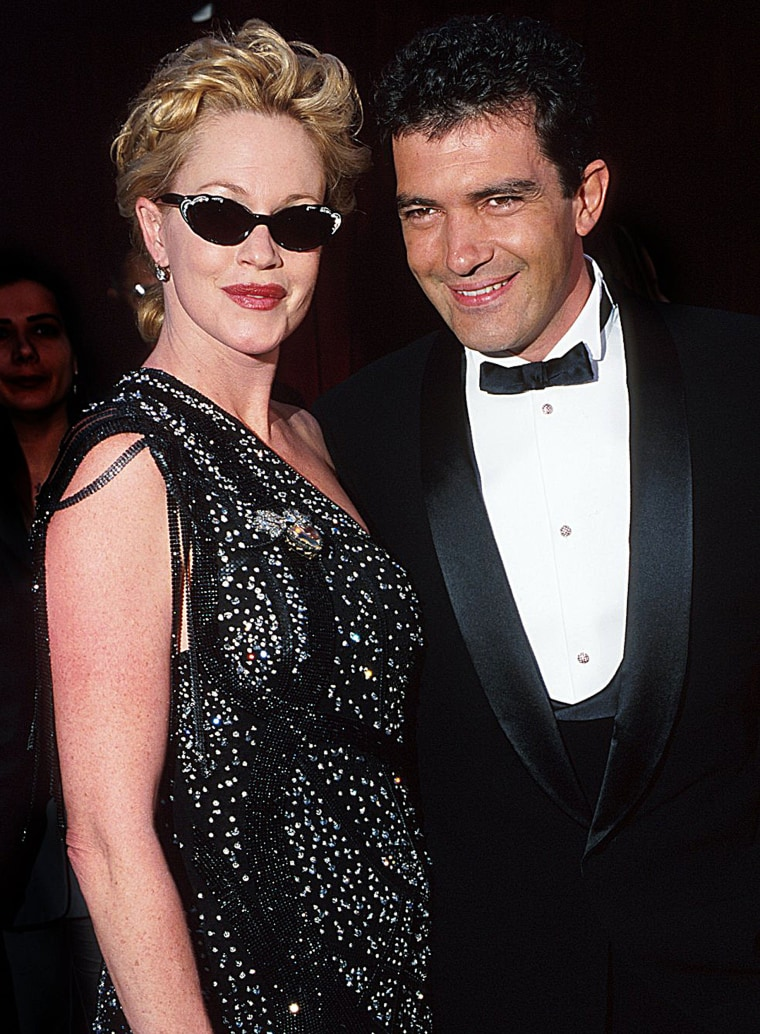 Melanie Griffith and Antonio Banderas during The 70th Annual Academy Awards - Red Carpet at Shrine Auditorium in Los Angeles, California.