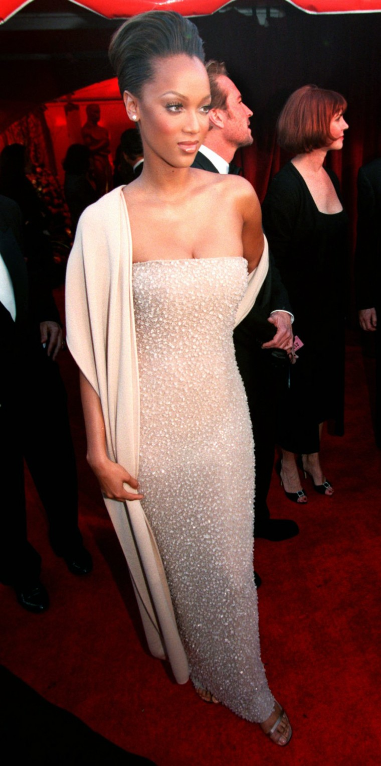 Supermodel Tyra Banks shows off her gown upon arriving at the 70th Annual Academy Awards in Los Angeles Monday, March 23, 1998.