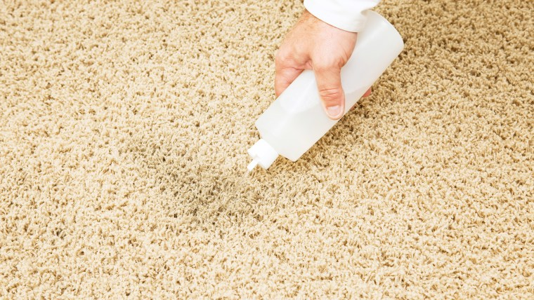 Treating Carpet Stain with Squeeze Bottle