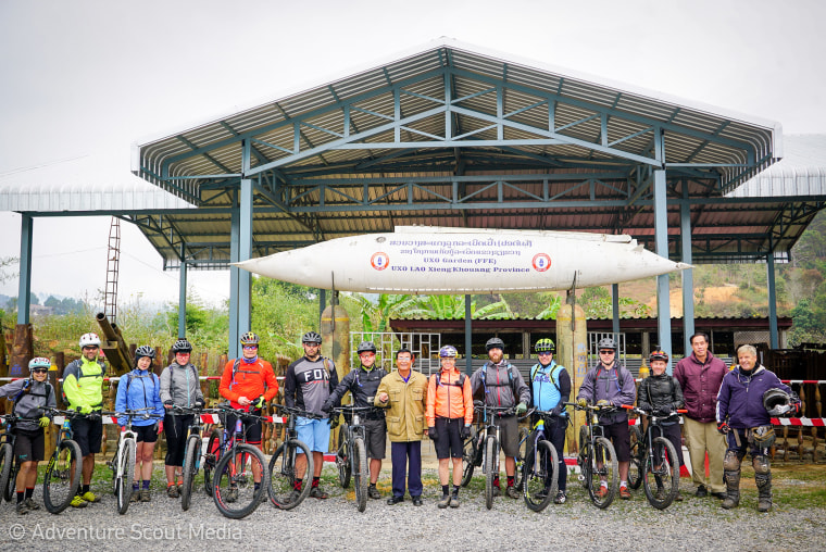 Mountain bikers on a trip tracing the Ho Chi Minh Trail in Laos lead by Rebecca Rusch. Funds from the trip go toward clearing the country of unexploded bombs.