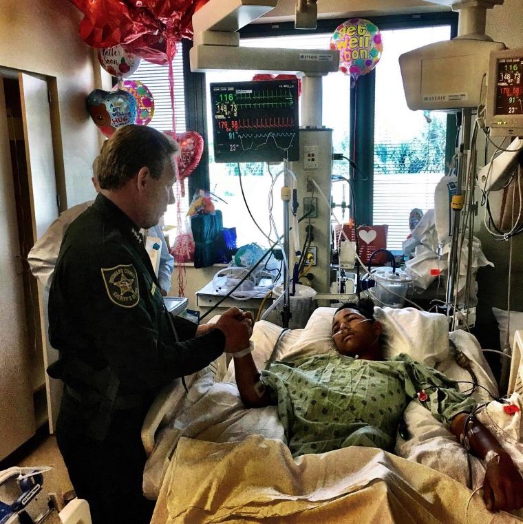 Image: Broward County Sheriff Scott Israel visits Anthony Borges in hospital