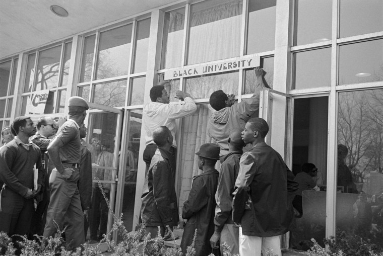 Image: Howard University students hang a sign in protest on the school's administration building