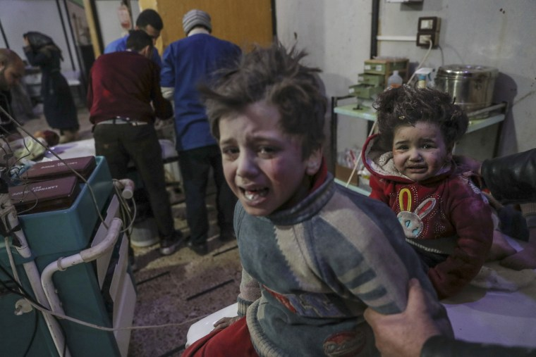 Image: Children are treated at a hospital in Douma, Syria