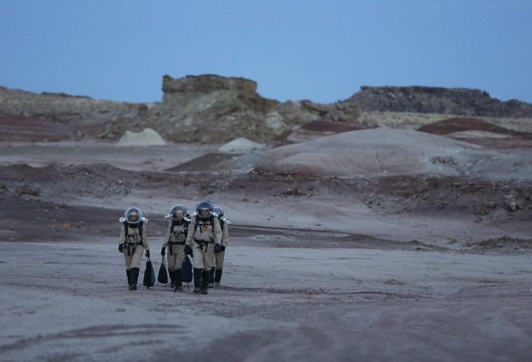 Image: Members of Crew 125 EuroMoonMars B mission return after collecting geologic samples in the Utah desert