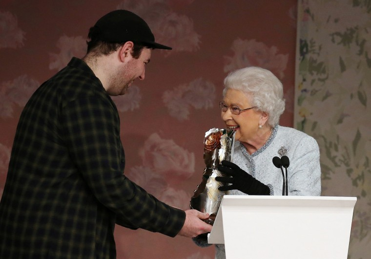 Image: Britain's Queen Elizabeth II presents the inaugural Queen Elizabeth II Award for British Design to Richard Quinn