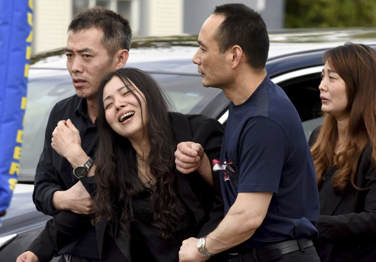 Image: Peter Wang's mother cries following her son's funeral